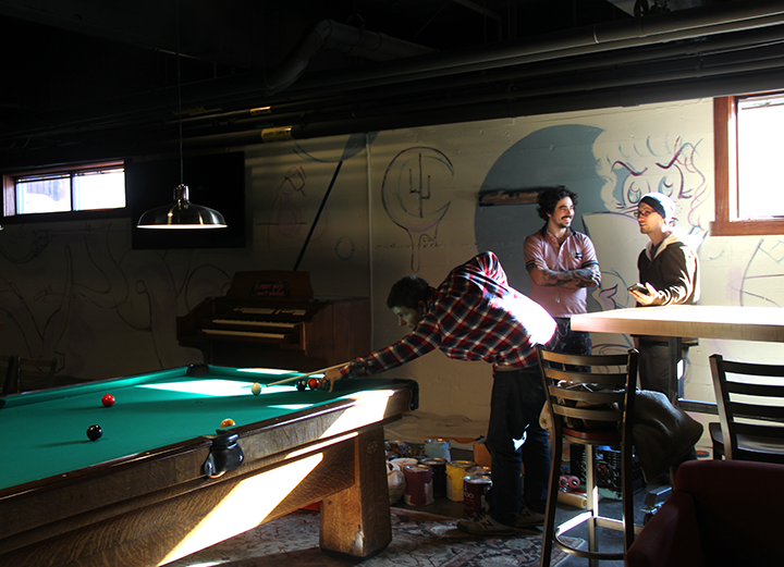 Pictured above are Andre Shank (playing pool), Michael Broth (left) and Chris Howdyshell (right).