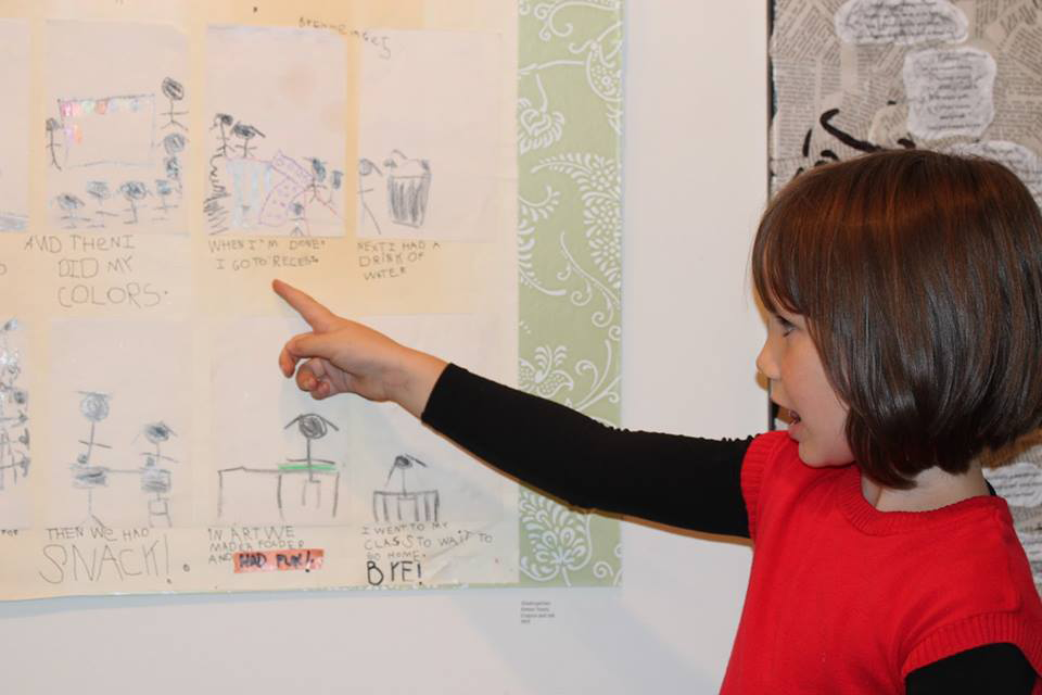 Emme Davis is proud of her artwork, My First Day of Kindergarten. Word Show. August 2016. Arts Council of the Valley. Photo Credit: Mary Rouse, Arts Council Board Member