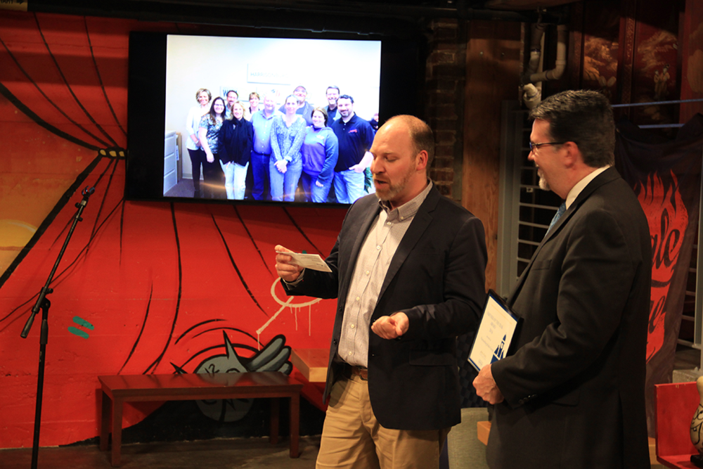 "HDR Board Member Kai Degner presents the Partner of the Year award to Steve Davis, Vice President of the Harrisonburg Radio Group. Photo Credit: Eleanor ""Nori"" Carter"