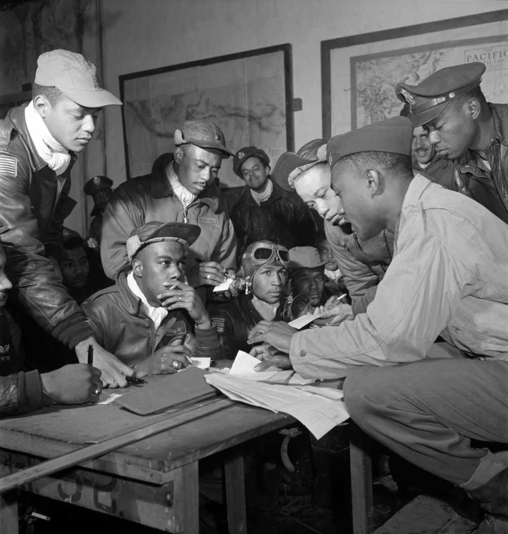 A group of Tuskegee Airmen makes strategic plans.