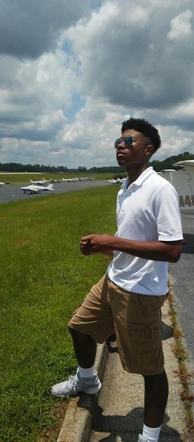 Channing Photo standing outside at Falcon Field.jpeg