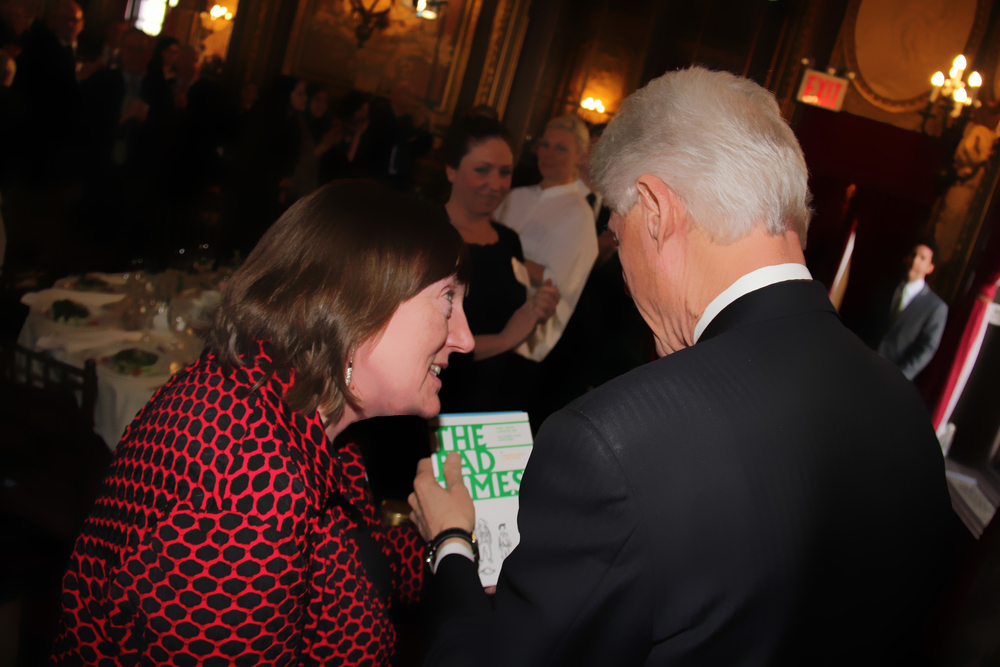 Christine Kinealy presenting a copy of THE BAD TIMES to former U.S. President Bill Clinton.