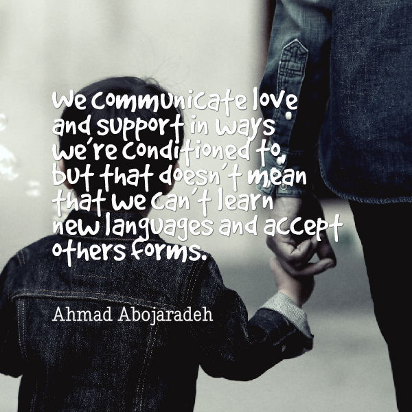 """Photo Description: a picture of a child holding a woman's hand, both wearing jean jackets. On the top left there's a quote """"We communicate love and support in ways we are conditioned to but that doesn't mean that we can't learn new languages and accept other forms"""" by Ahmad Abojaradeh."""