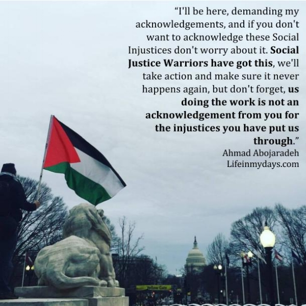 Photo Description: A man carries a palestinian flag by a statue for a lion in Union Square overlooking Capital Hill.