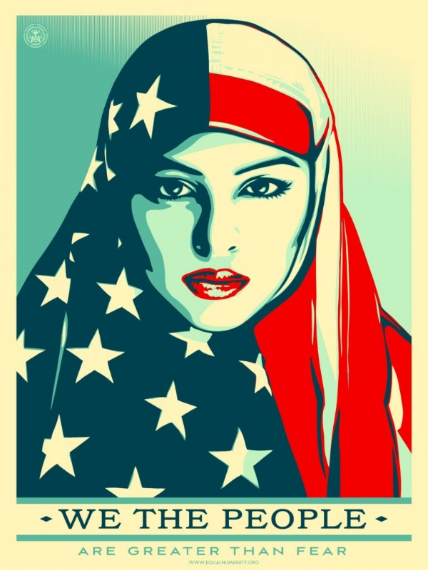 "Photo Descriptipon: A poster for the Women's March by Shepard Fairey of a Muslim woman wearing an american flag as a scarf. On the bottom it says ""WE THE PEOPLE ARE GREATER THAN FEAR."""