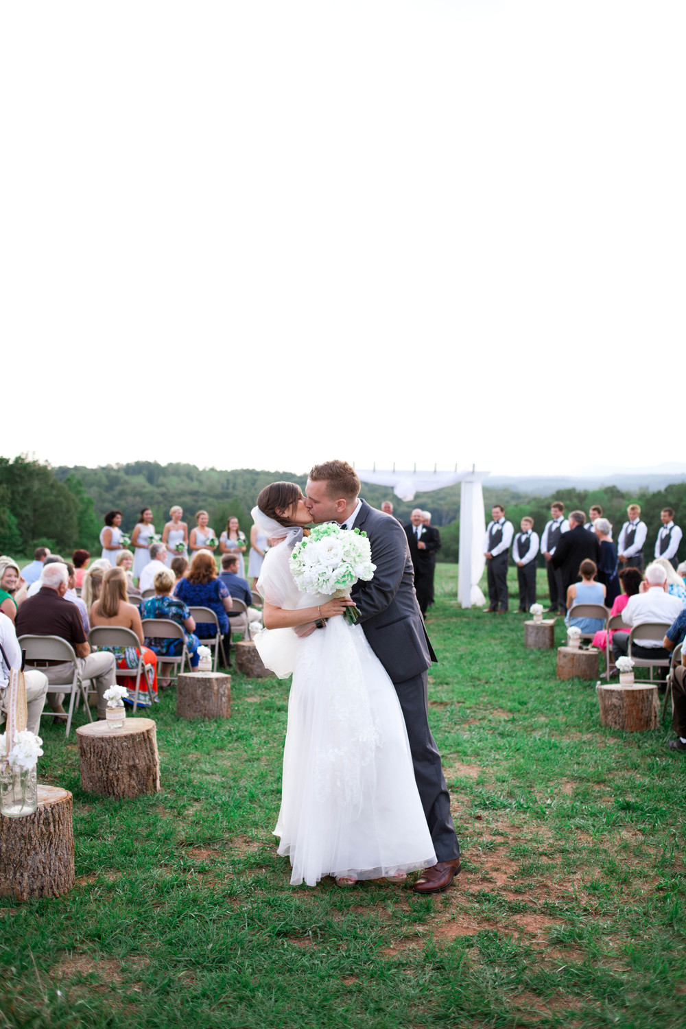 first kiss, lindsey plantation, sc wedding photographer, unplugged ceremony, poured out photography, rustic, lace, barn, field,