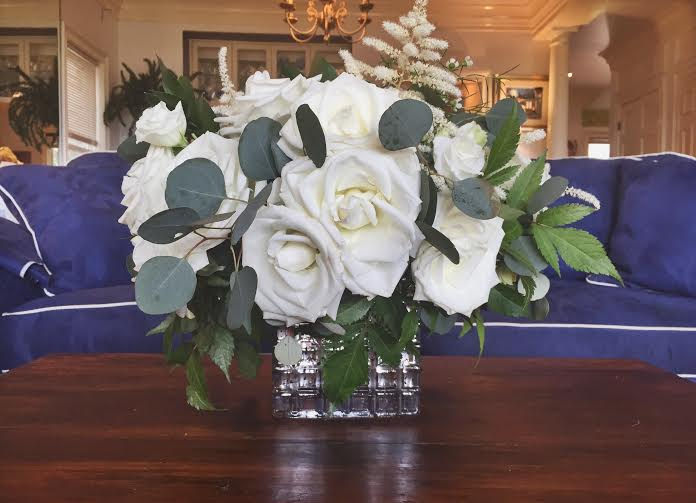 White Rose Arrangement against Blue Couch.jpg
