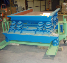 Vibrating table conveyor
