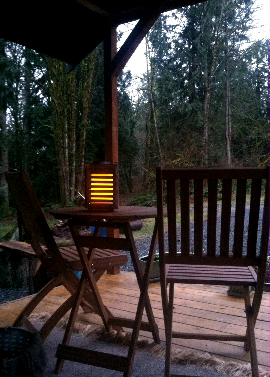 The Westerwisp cabin kitchen deck just before night fall. A cozy spot to listen to the frogs and owls after a long day of working the yard.