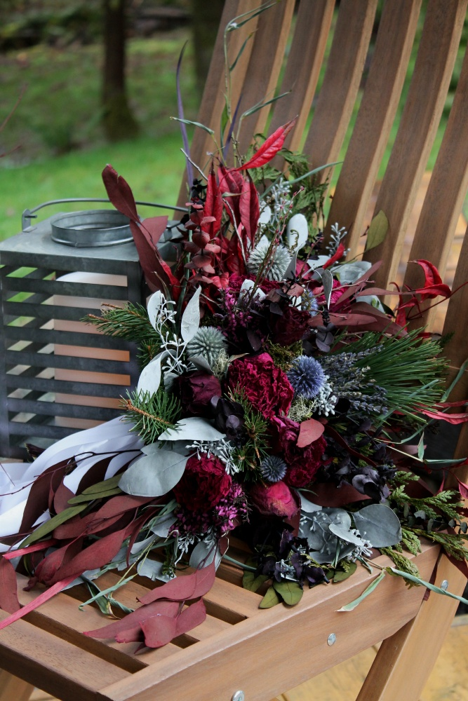 Berry tones, red and blue bouquet perched on the Westerwisp Woods porch.