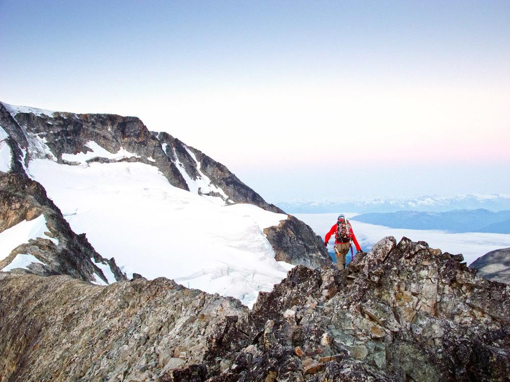 Lone climber on a knife edge ridge. Wedge Mountain, Canada
