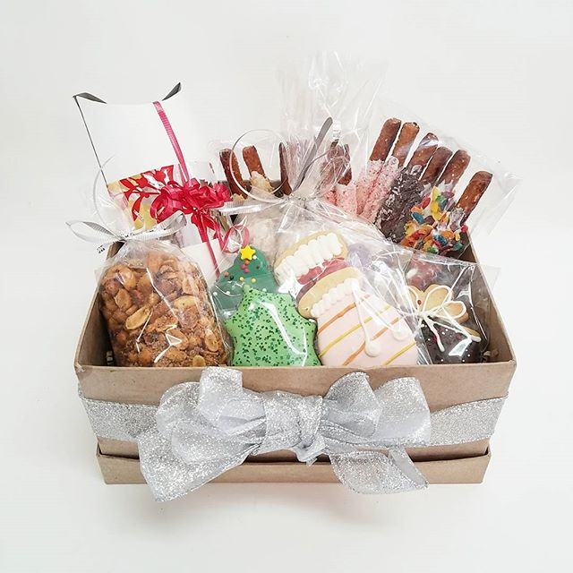 These holiday gift boxes are perfect for client gifts, teacher gifts, or your holiday party. Give us a call to reserve yours today!
