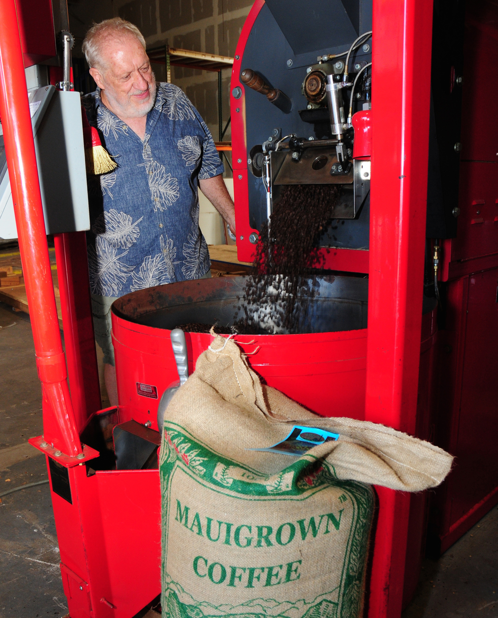 Jeff Ferguson of MauiGrown Coffee Company Store checks the freshly roasted Maui Mokka for quality and consistency.