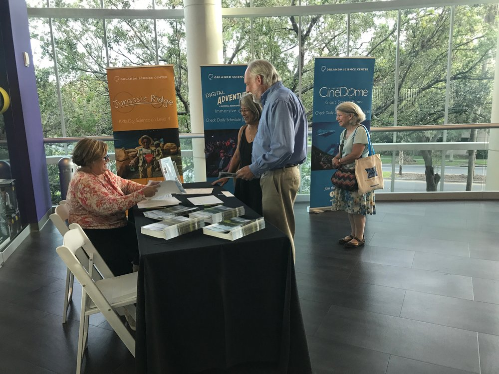 Volunteer Susan Burhoe welcoming our guests. Photo courtesy of CEJ Fellow Samantha Koempel.