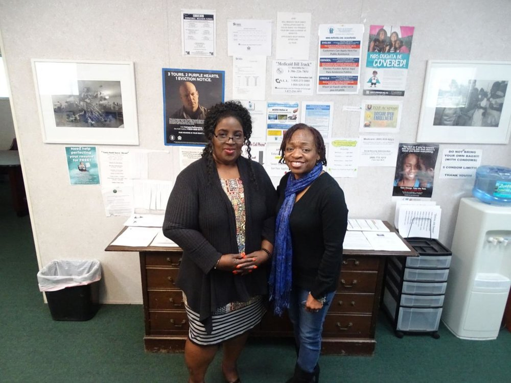 HOW CAN WE HELP?  — Spring Hill Resource Center Administrator Shilretha Dixon, left, and Administrative Assistance Wanda Raulerson are ready to help clients who visit the Resource Center. Behind them is a wall of information to help clients navigate various programs to help them find healthcare, housing, jobs, and more.  BEACON PHOTO/ELI WITEK