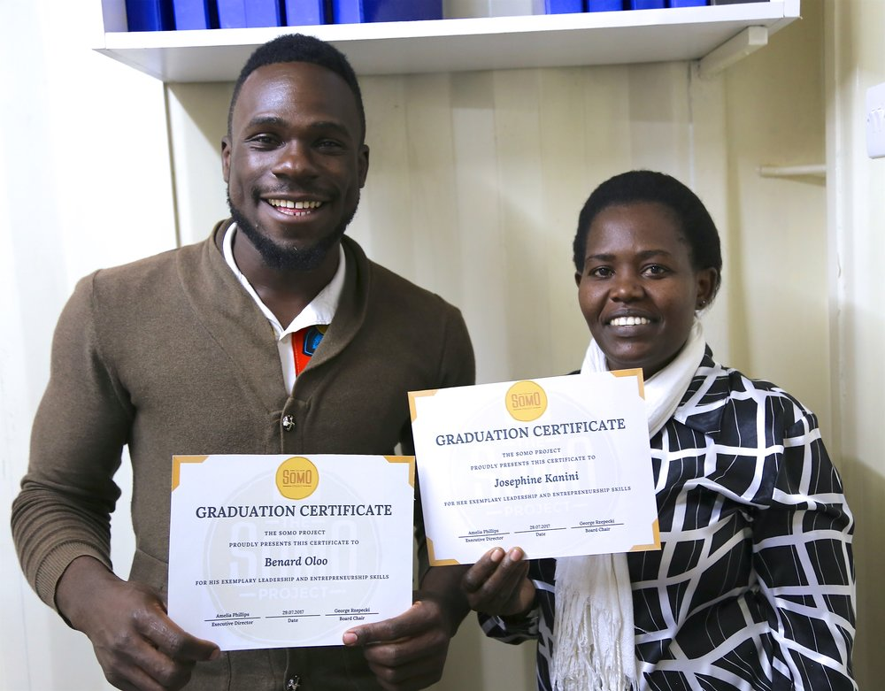 Bernard and Josephine with graduation certificates