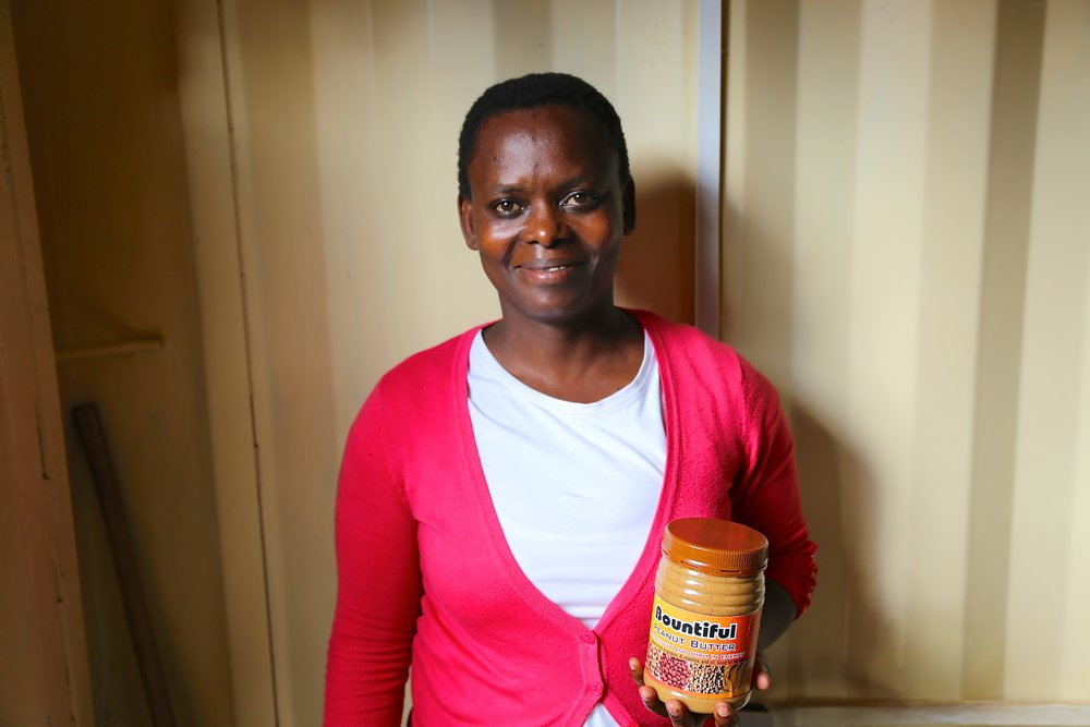 Somo trainee Rose with her organic peanut butter 2.JPG