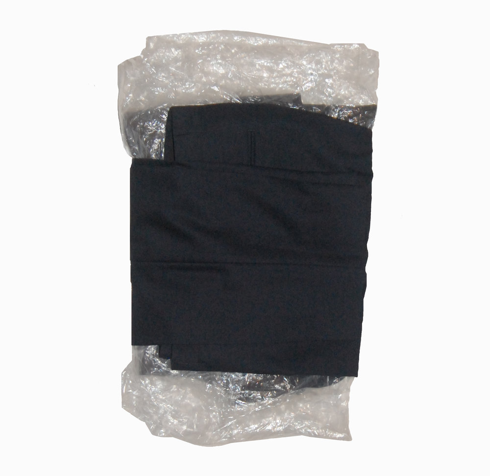 Fold the trouser bottom hem over the jacket, and then fold the top half of the trousers over the jacket.