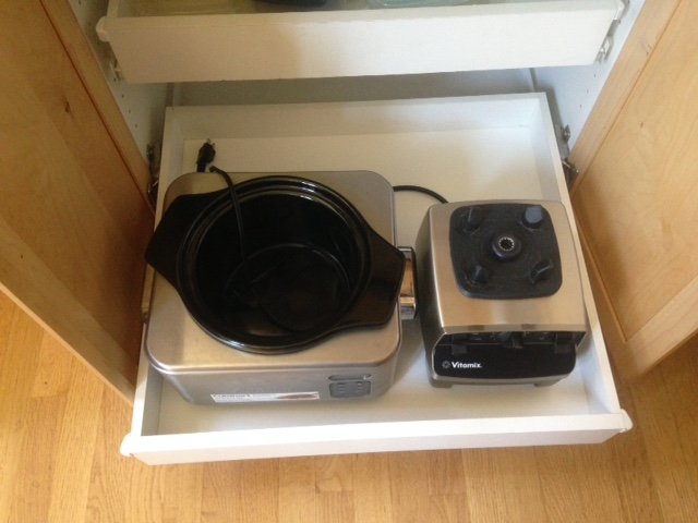 Clear off valuable countertop space.  House small appliances in drawers.