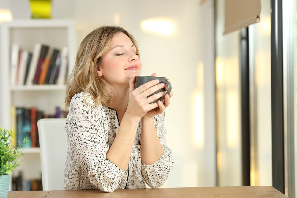 woman sipping coffee postcard.jpg