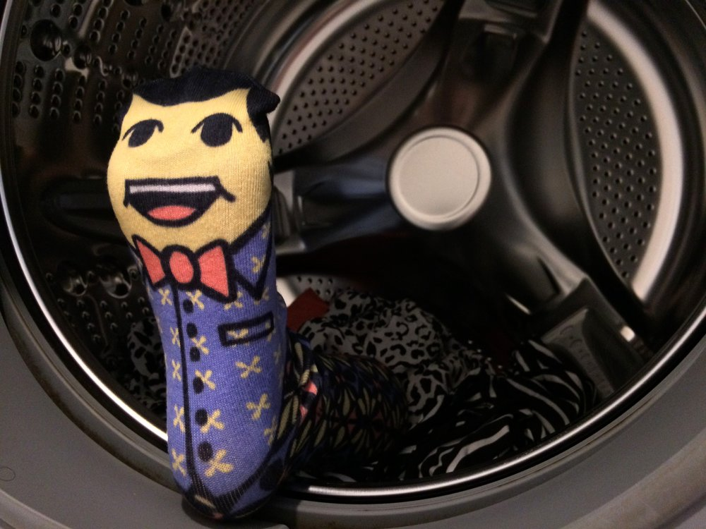 Socki finds himself inside the washing machine. Get your copy of Volume 1 to read about his adventure! Photo Credit: The Sock Review
