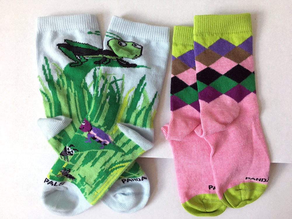 "A closer look at the cute socks in ""June the Grasshopper"" Socktivity subscription packet. Photo credit: The Sock Review"