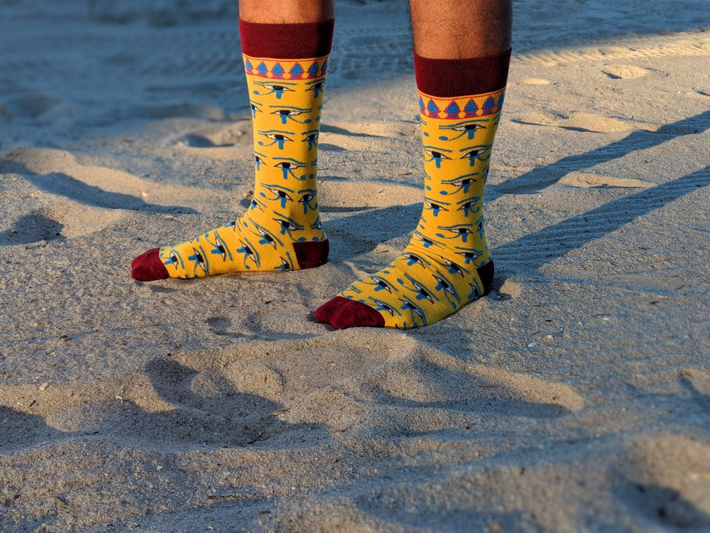 Egyptian Eyes Socks - inspired by  Coffin of Khnumnakht  piece featuring the hieroglyphic artwork of the eyes. Photo Credit: The Sock Review