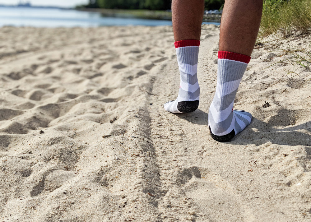 The Arrow Grey style pictured here - take a walk on the beach, or the city streets, with your J.Clay socks - Photo Credit: The Sock Review