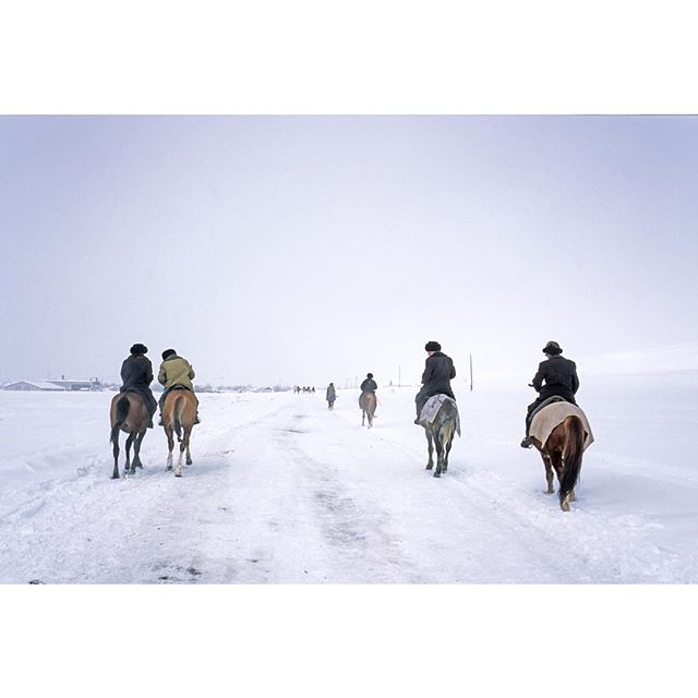 4 (ok 5 or 6) horsemen on their way to a funeral Kyrgyzstan 🇰🇬, way back in 2003 with @jd_hare and @trilogylandscapes on our ski trip/road trip for @patagonia. - - - - #centralasia #horse #skitrip #roadtrip #vodkacowboys #tianshan #travel