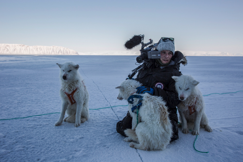 Nic Donnelly, director of photography, in Greenland shooting for NatGeo's special 'The Last Ice'. Photo taken immediately after their dog sled fell through sea ice. it took 45 minutes to rescue the dogs. one could not be saved.