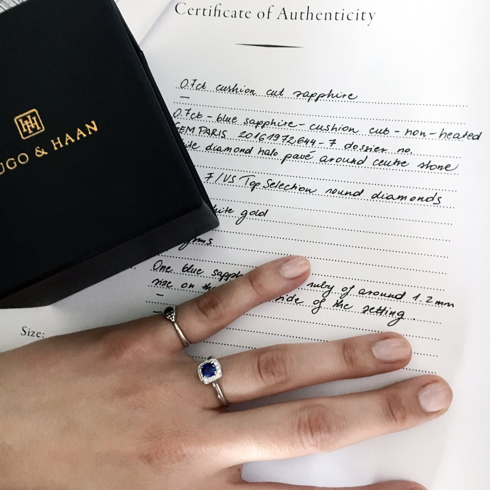 Ready for a grand proposal - The finished design not only had the wing details under the setting but also a small blue sapphire and ruby that represented the bride and the groom on the sides.