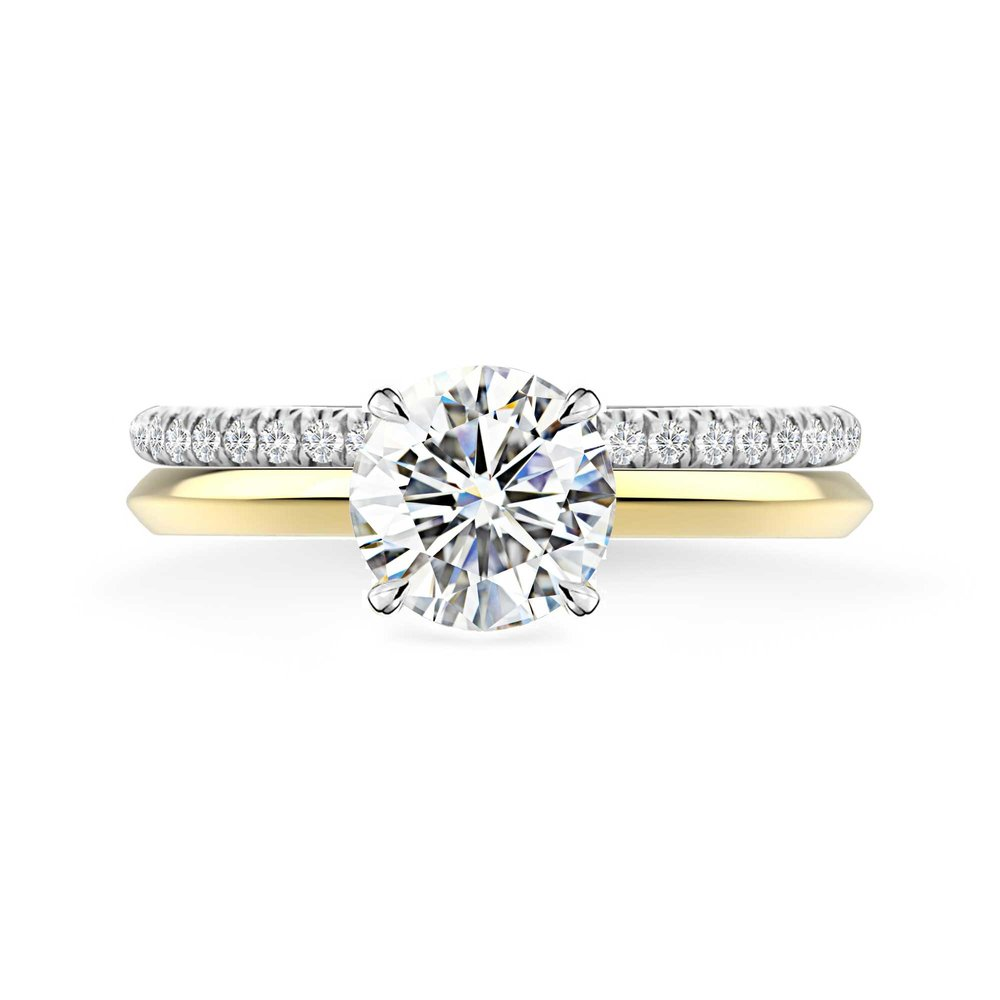 Wedding band friendly engagement ring - We have created this brilliant cut diamond engagement ring design in a way that most wedding band sit snug next to it if she chooses to wear it on the same finger.