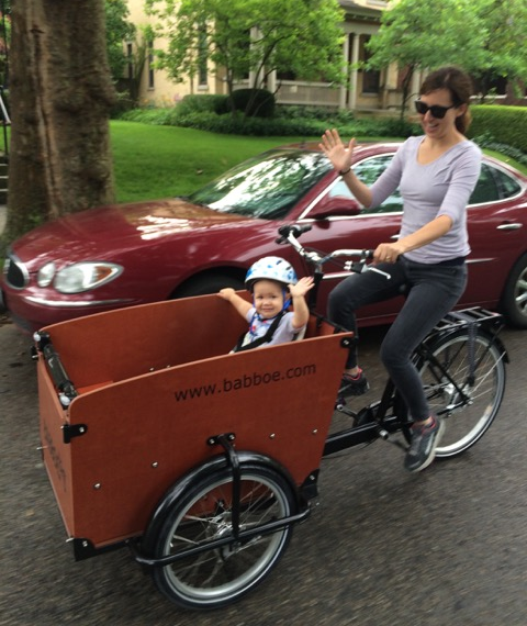 Yay Bikes! Board Chair, Emily, has fostered a culture of biking in Columbus in everything she does. She's pictured with her young daughter who she travels with regularly.