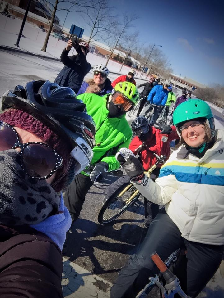 Ride Leader Jen Cowley (in the saucy teal helmet) with a pack of intrepid cyclists. Photo credit: Kathleen O'Dowd