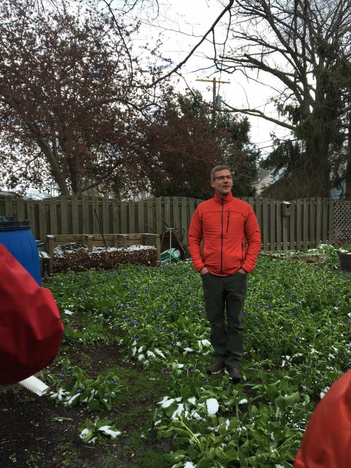 Mike Sapp standing in a bed of Kentucky bluebells as he tells us about rain barrels, composting and other at home earth friendly ways to live.