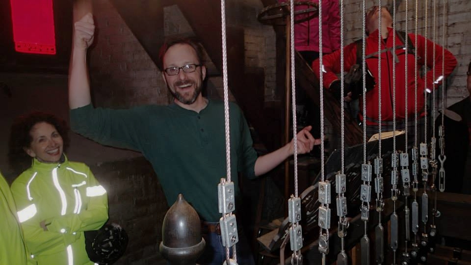 Ringing the bells of Trinity Episcopal on the Year of Yay! ride he led to various places of worship.