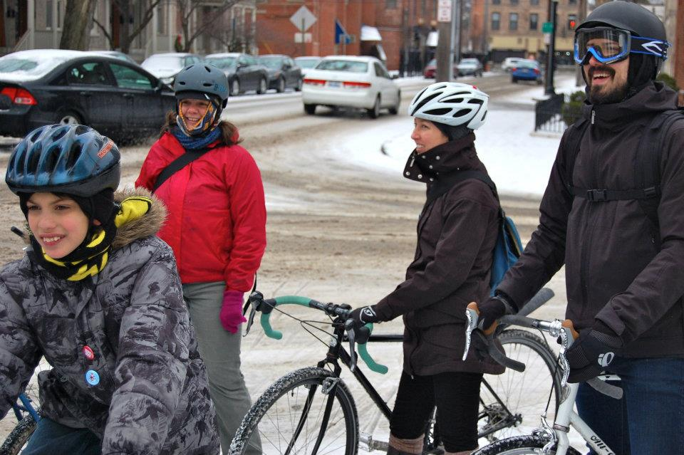 Gloria's oldest (lower left) rode his own bike on super slushly streets during his first Year of Yay! ride.