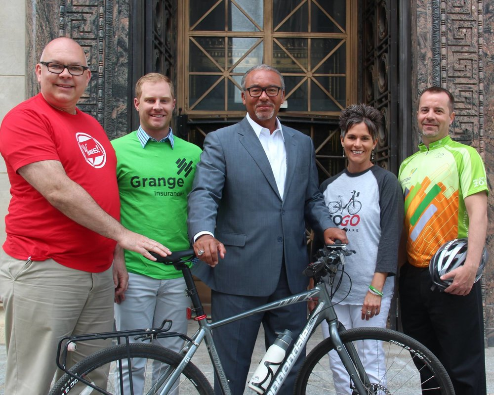 "With former Columbus Mayor Michael ""Bikin' Mike"" Coleman, promoting bicycling alongside several Grange colleagues."