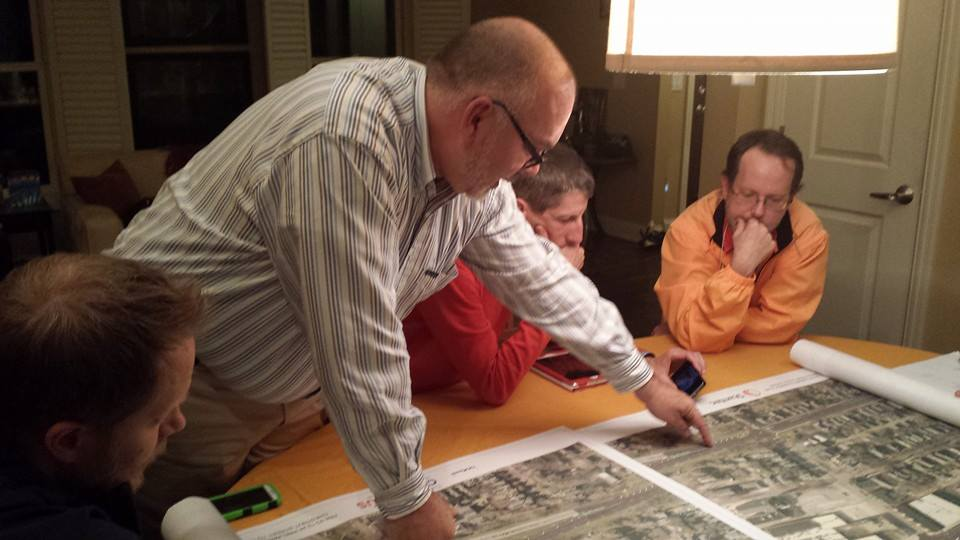 Duane pores over a map of the proposed (now installed!) bicycle infrastructure on Summit & Fourth Streets, near his Italian Village home.