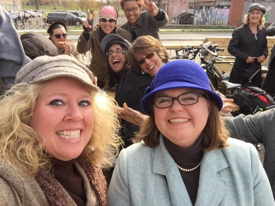 Rockin' a purple hat, with friends, on a recent Tweed Ride.