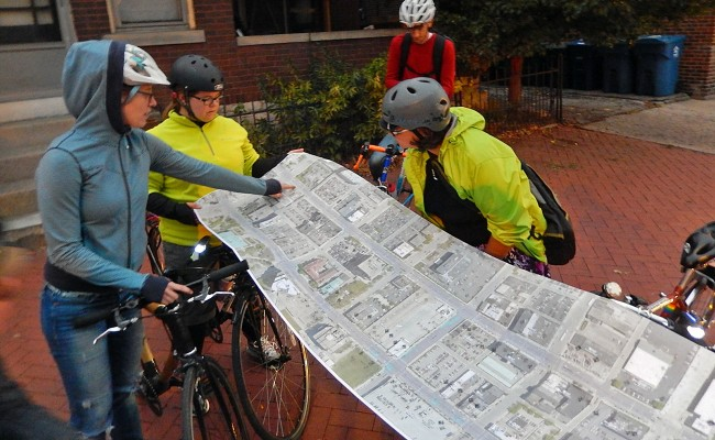 Rahel, center, reviewing a map of proposed changes to Downtown Columbus' streetscape.