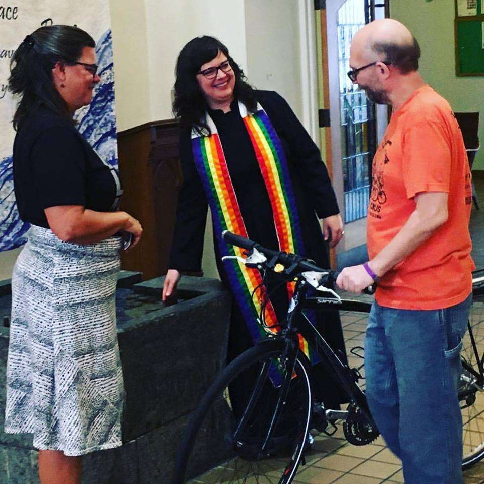 Yay Bikes! member Nik Olah getting blessed at Summit on 16th United Methodist Church's 2017 Blessing of the Bicycles.