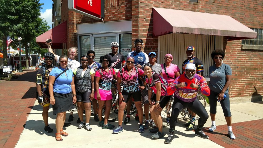 Members of Black Girls Do Bike, Major Taylors, Cycle Nuts and Yay Bikes! before chowing down during a ride to London OH.