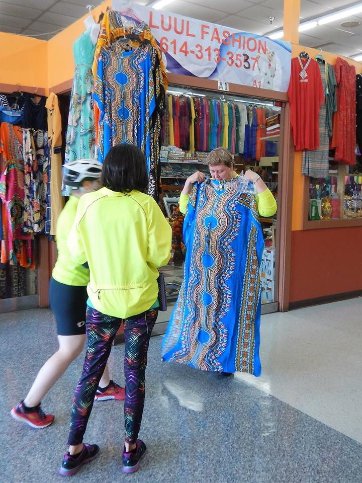 Ride leader Nancy Niemuth considers a garment. Photo credit: Keith Lugs