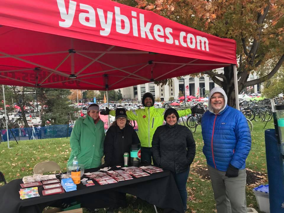 Sarah, second from left, braves the cold to park bikes at an OSU game. Photo credit: Deo Martinez