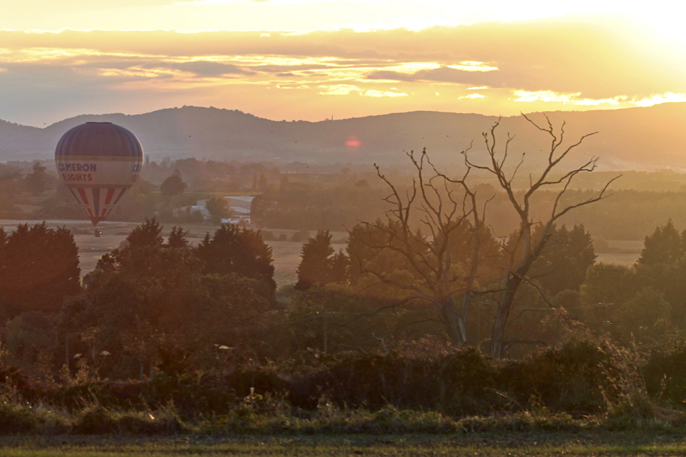 Malvern Hills and Hot air balloon at Sunset from Defford