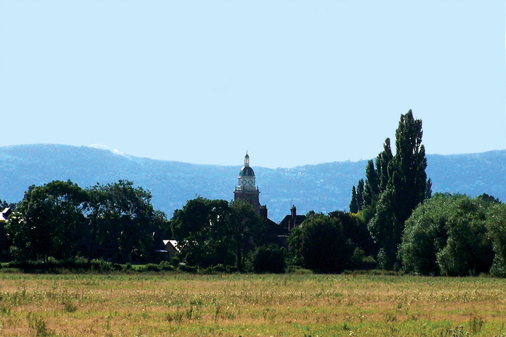 The Pepperpot Tower at Upton-on-Severn against the Malvern Hills