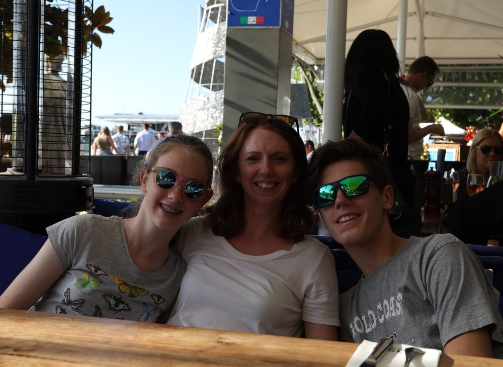 Claire with Lewis & Ella at a waterfront restaurant