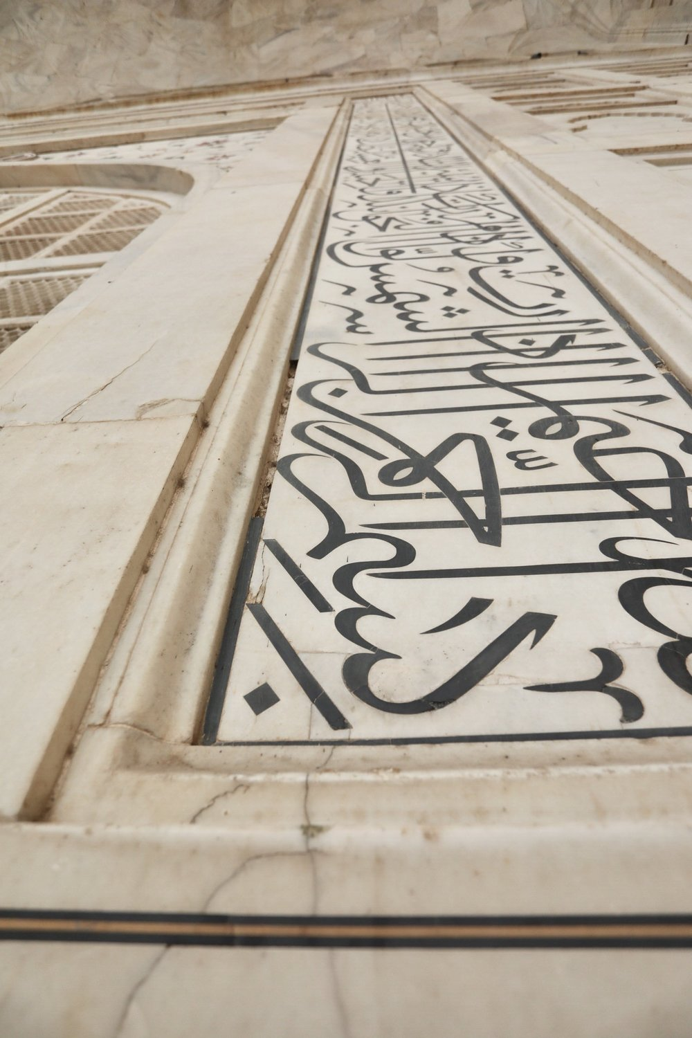 It's hard to believe but every single letter, like the pattern has been inlaid in the marble.