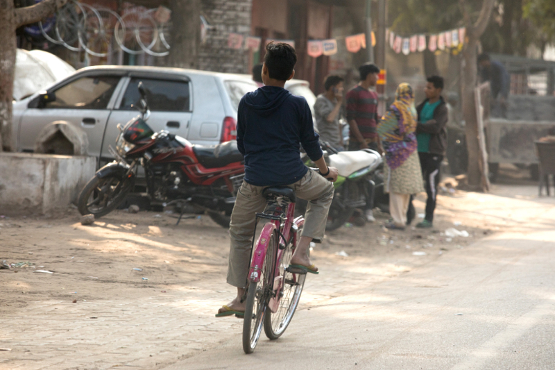 Boy on bicycle, Agra, Uttar Pradesh, India
